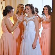Bride in bridal dress with bridesmaids during preps