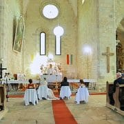 Bride and groom in front of the altar, church in Hungary on the wedding day - Eger, Belapatfalva